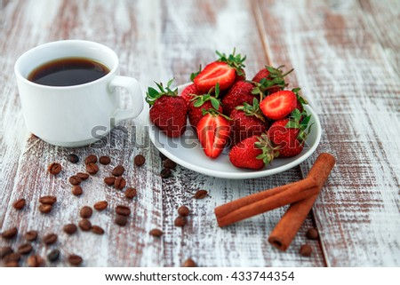 delicious breakfast with a cup of coffee and strawberries - stock photo