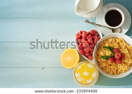 Delicious breakfast with coffee, fresh berries on old wooden background  - stock photo