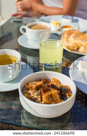 Delicious breakfast with flakes,dried fruit and cup of hot coffee