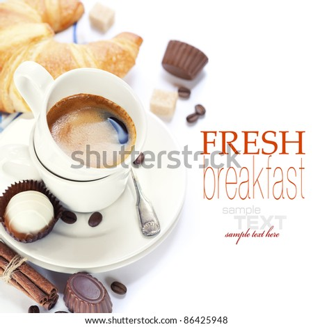 Delicious breakfast with fresh coffee, fresh croissants and chocolate (with sample text) - stock photo