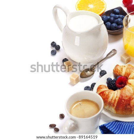 Delicious breakfast with fresh coffee, milk,  fresh croissants and fruits - stock photo