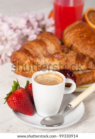 Delicious breakfast with hot coffee and croissant