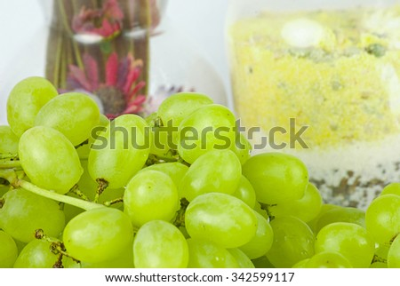 delicious bright fresh green grapes on a branch