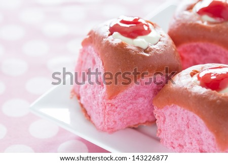 Delicious, brightly colored pink coconut guava sweet rolls filled with cream cheese custard and topped with guava juice concentrate