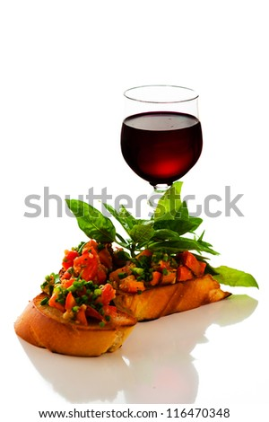 delicious bruschetta appetizer on white background - stock photo