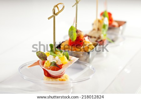 Delicious Buffet Food on White Dish - stock photo