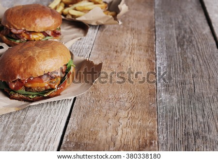 Delicious burger on the table - stock photo