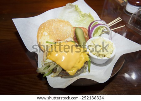 Delicious burger with beef, tomato, cheese and bell pepper. - stock photo