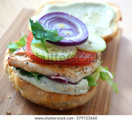 Delicious burger with chicken and vegetables.