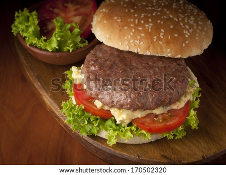 delicious Burger with tomato and lettuce - stock photo