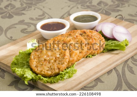 Delicious burgers Patties served with fresh salad - stock photo