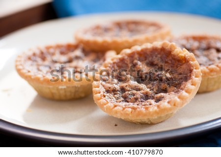 delicious butter tarts with raisins and a flaky crust - stock photo