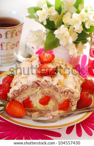 delicious cake-meringue swiss roll with whipped cream,fresh strawberry and almonds - stock photo