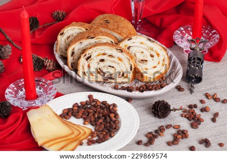 delicious cake on New Year's table with red candles and pine cones still life - stock photo