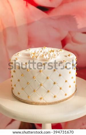 Delicious cake. White Cream Icing Cake with and White Chocolate. Wedding cake. - stock photo