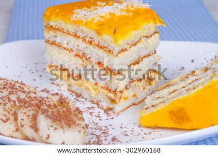 Delicious cake with banana jelly and banana slices, sprinkle with grated chocolate