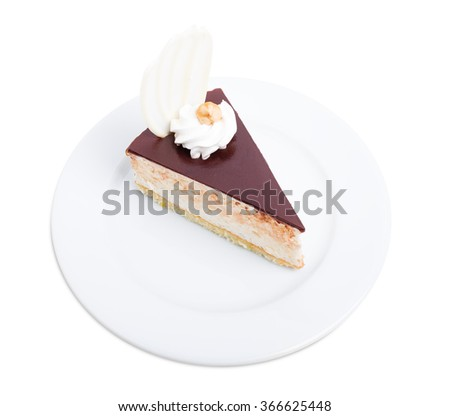 Delicious cake with chocolate curl and hazelnut. Isolated on a white background. - stock photo