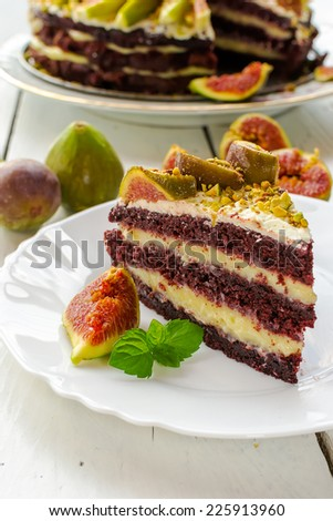 Delicious cake with vanilla cream and garnish with fresh figs - stock photo