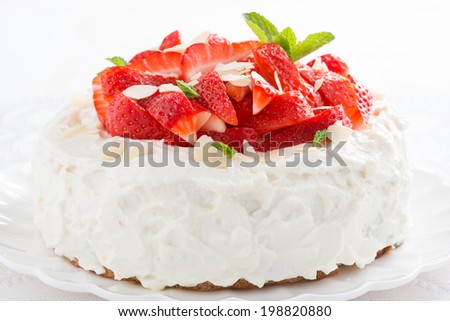 delicious cake with whipped cream and fresh strawberries, close-up - stock photo