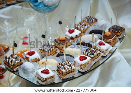 Delicious cakes and pralines  - stock photo