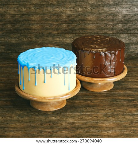 Delicious cakes: chocolate and with yellow-blue icing stands on wooden background - stock photo