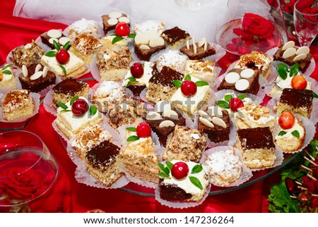 Delicious cakes on red - stock photo