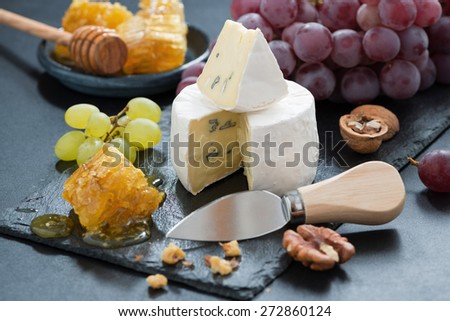 delicious Camembert with fresh honey, grapes and nuts, horizontal - stock photo