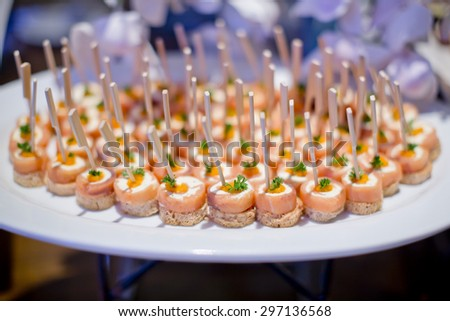 Delicious canapes as event dish - stock photo