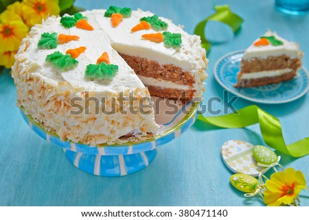 Delicious carrot cake on a table decoration for Easter holiday - stock photo