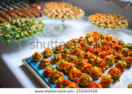 Delicious catering canapes on a buffet table - stock photo