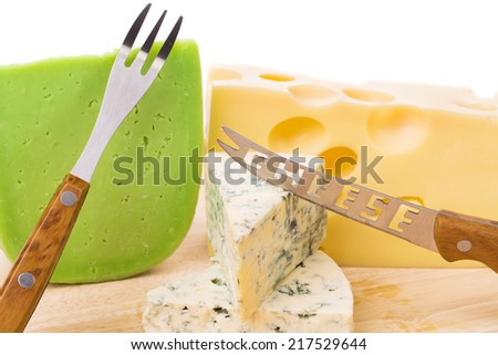 Delicious cheese and knife on wood platter. Whole background. - stock photo