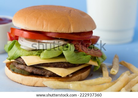 Delicious Cheese Burger� with� Milk� and Tomato Sauce