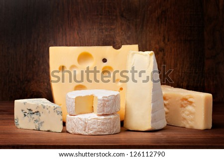 delicious cheese on a wooden table - stock photo