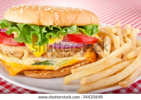 delicious cheeseburger with melted cheese and french fries