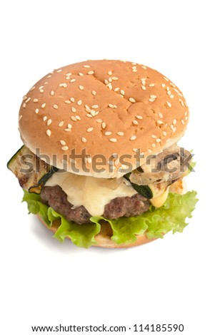 Delicious cheeseburger with mushrooms and zucchini isolated on white - stock photo