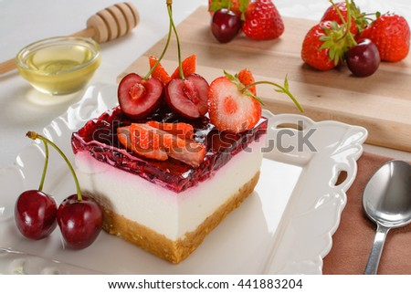 Delicious cheesecake with berries,fresh strawberry and cherry cheesecake on table.  - stock photo