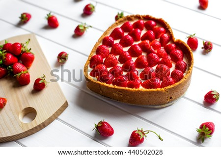 Delicious cheesecake with berries on table close up - stock photo
