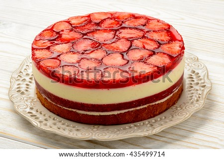 Delicious cheesecake with strawberry mousse, strawberry jelly and strawberries. - stock photo