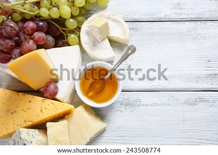 Delicious cheeses with honey, tasty food - stock photo