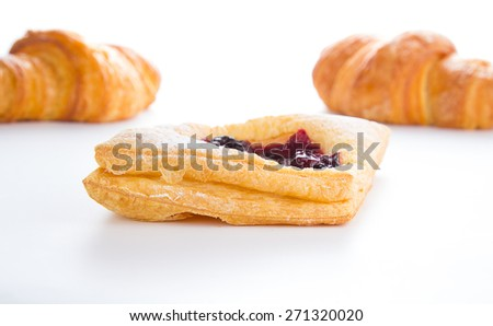 Delicious Cherry puff pastry with croissants isolated on white - stock photo