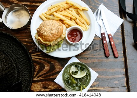 delicious chicken burger with potato fries and ketchup and mojito ...