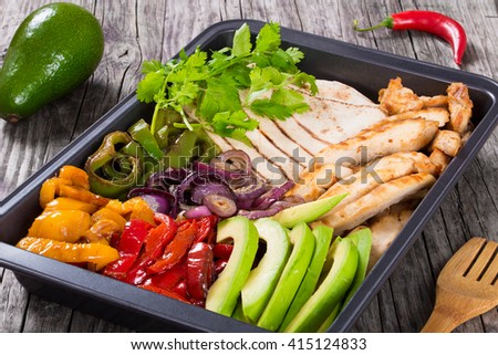 Delicious Chicken Fajita Platter with Avocado, Bell Pepper, Red Onion and Cilantro, close up, top view