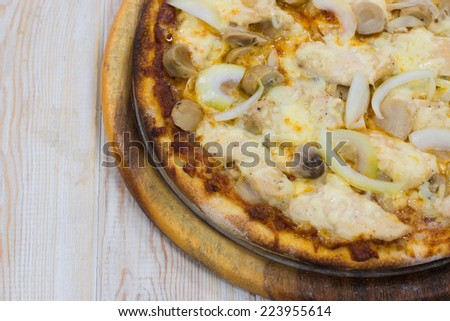 Delicious chicken pizza close up on wood table - stock photo