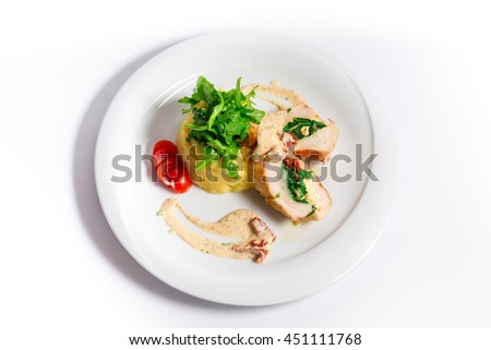 Delicious chicken rolls stuffed with spinach , on mashed potatoes