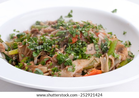 delicious chicken stir fry with fresh vegetables and sprouts - stock photo
