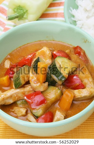 Delicious chicken with curry - stock photo