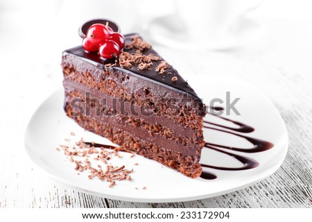 Delicious chocolate cake on plate on table on light background