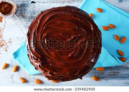 delicious chocolate cake with nuts on table - stock photo