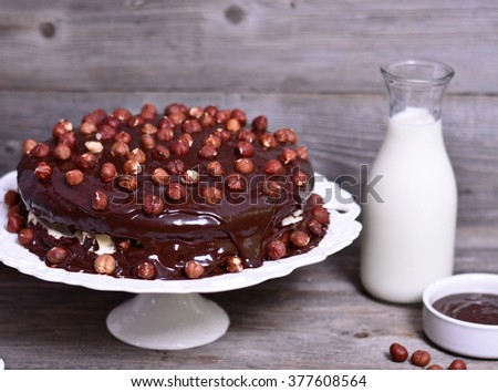 Delicious chocolate cakes with hazelnut on table and dark chocolate - stock photo
