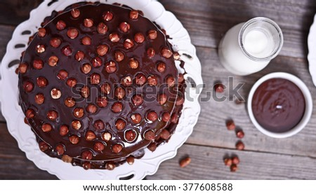 Delicious chocolate cakes with hazelnut on wooden table - stock photo